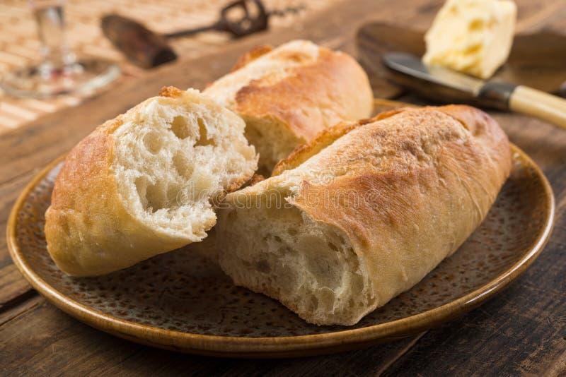Французский хлеб с маслом стоковое изображение