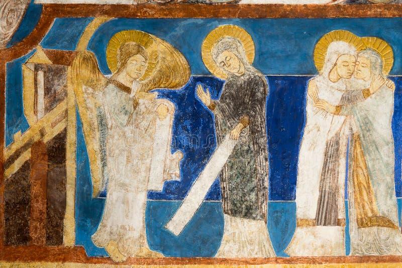 Фреска романск аннунциации Ангел Габриэль говорит Mary что она принесет сына стоковые фотографии rf