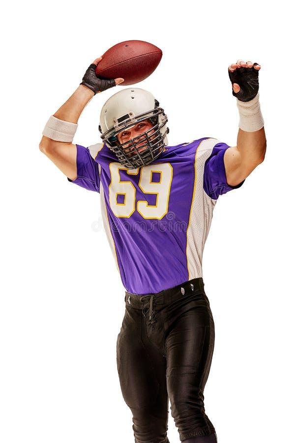 Футболист в действии с шариком в руке изолированной на белой предпосылке стоковое изображение