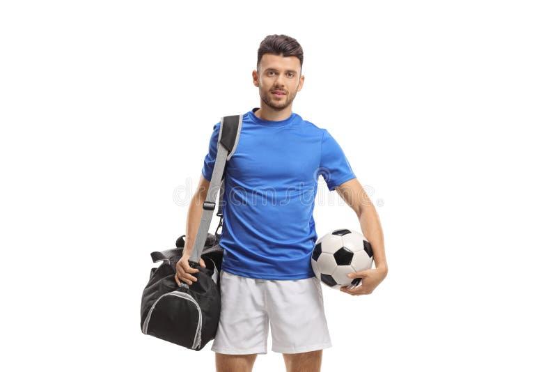 Футболист со спорт кладет в мешки и футбол стоковое фото rf