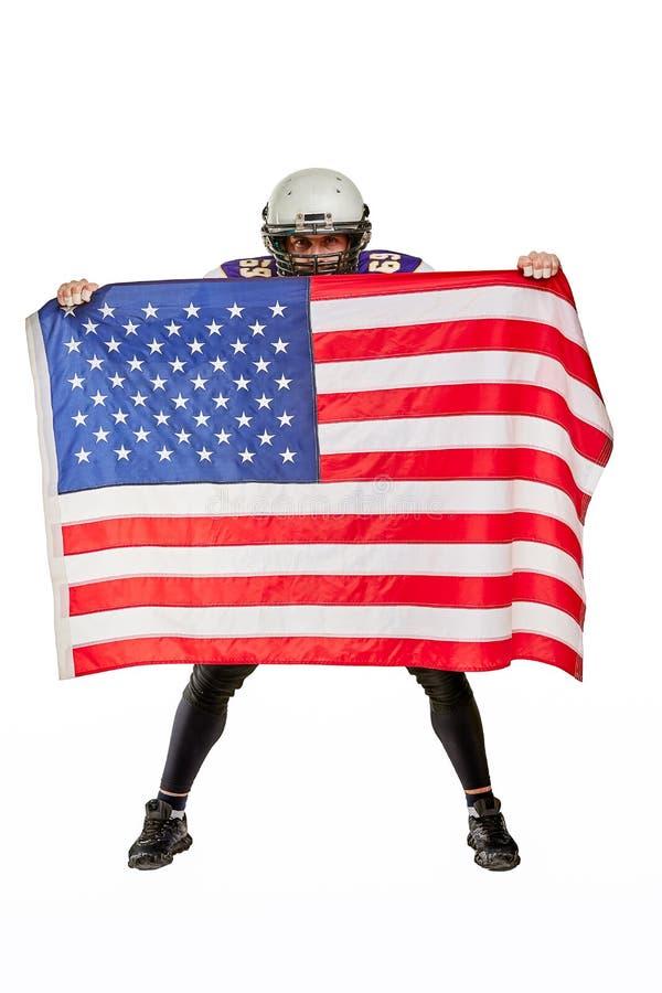 Футболист с формой и американским флагом, на белой предпосылке стоковое изображение