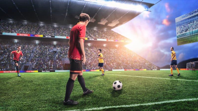 Футболист prepairing для того чтобы принять свободный удар на футбольном поле стоковое изображение