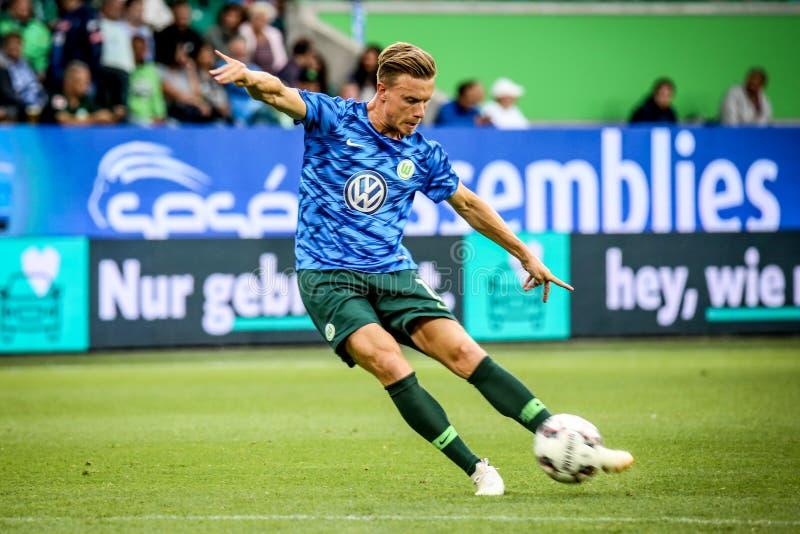 Футболист Yannick Gerhardt пиная шарик стоковая фотография rf