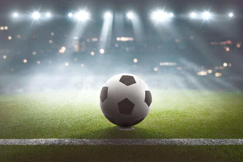 Футбольное поле с шариком на стадионе и светах стоковое фото rf