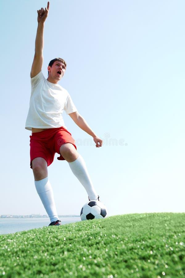 футбол игрока крича стоковое изображение