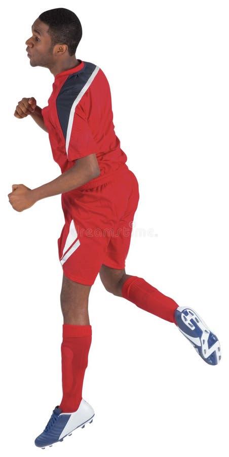Футболист в красный скакать стоковые фотографии rf