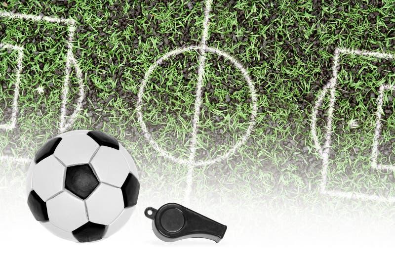 Футбольное поле, шарик и свисток рефери стоковые фото