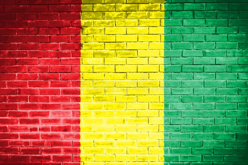 Флаг Гвинеи, предпосылка текстуры стены стоковые изображения