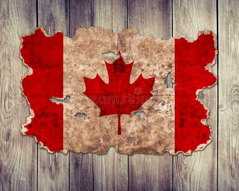Флаг Канады в форме сорванной винтажной бумаги стоковое изображение