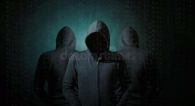 Хакеры в тенях стоковые изображения rf