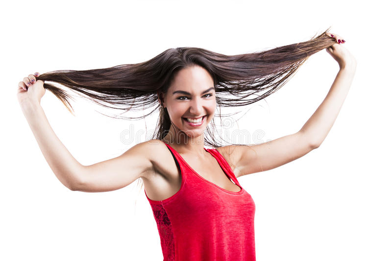 хватая волосы ее женщина стоковое фото rf