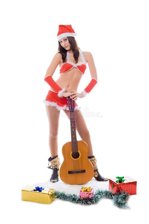 хелпер santa гитары девушки стоковые фото