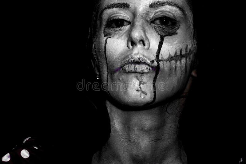 Хеллоуин покрасил женщину стоковое фото rf