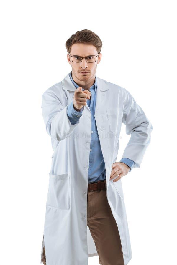 Химик указывая на вас стоковая фотография