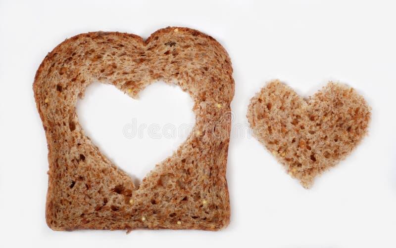 Хлеб всей пшеницы с сердцем стоковое фото