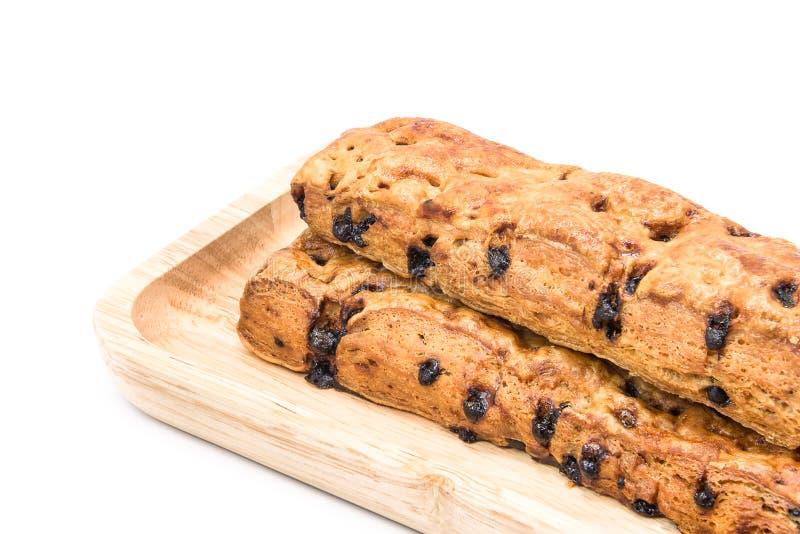 Хлеб ручки обломока шоколада с деревянной плитой на белой предпосылке стоковые фото