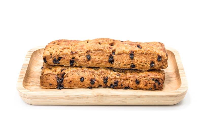 Хлеб ручки обломока шоколада с деревянной плитой на белой предпосылке стоковая фотография