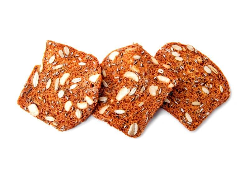 Хлеб Multigrain отрезает конец-вверх изолированный на белой предпосылке стоковые изображения rf