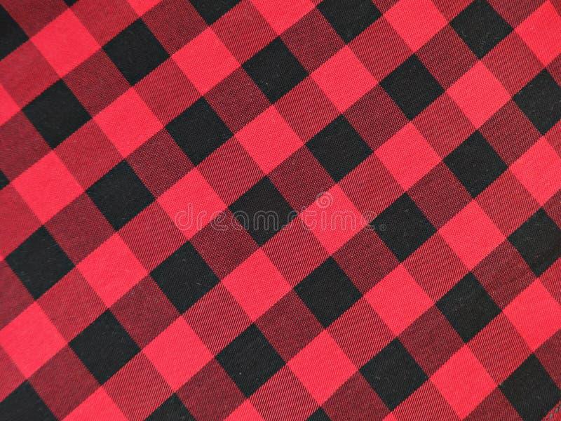 Хлопко-бумажная ткань в черной и красном цвете checkered стоковое фото