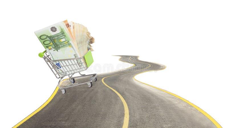 ходить по магазинам с тележкой и деньгами на изогнутой дороге стоковое изображение rf