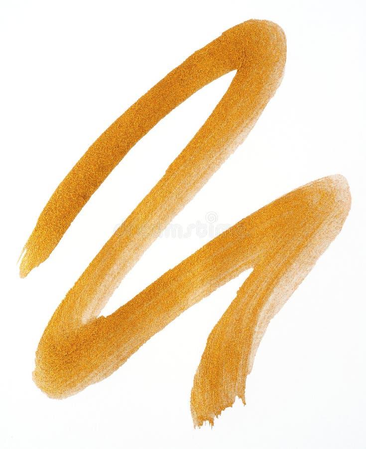 Ход краски золота над белизной стоковая фотография