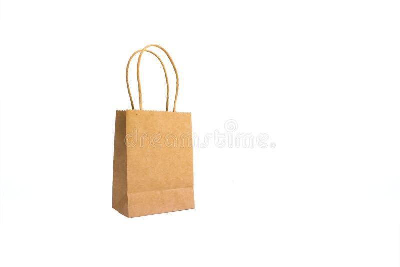 Хозяйственная сумка бумаги Брауна изолированная на белой предпосылке стоковое изображение