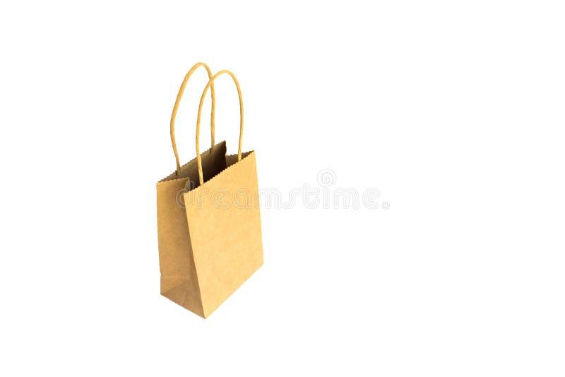 Хозяйственная сумка Opend коричневая бумажная с руками изолированными на белой предпосылке стоковые фотографии rf