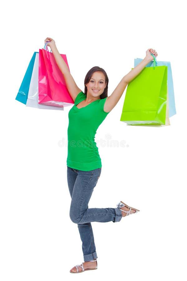 Хозяйственные сумки нося сногсшибательной молодой женщины стоковая фотография rf