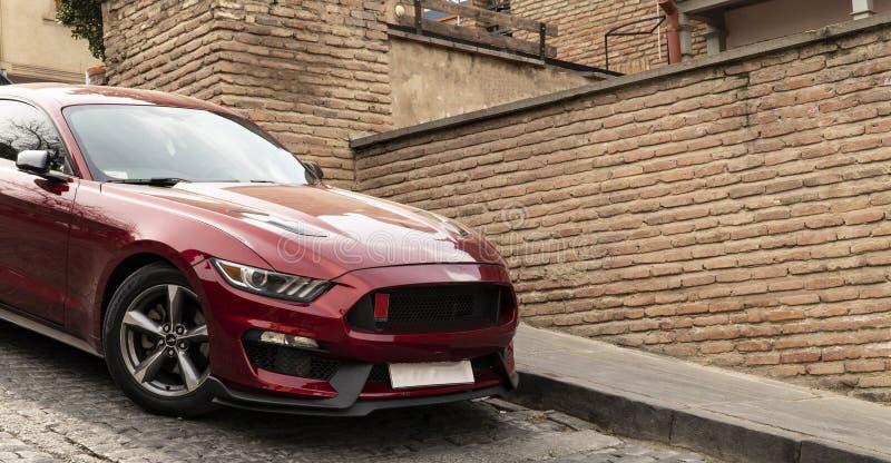 Холодный красный автомобиль стоковые фотографии rf