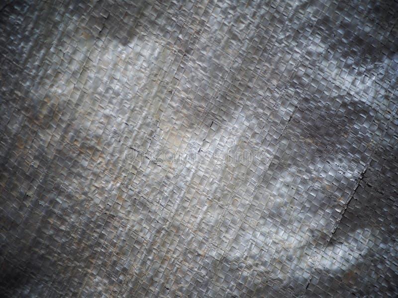 Холст дефекта Grunge пакостным сплетенный серебром пластичный стоковые фотографии rf