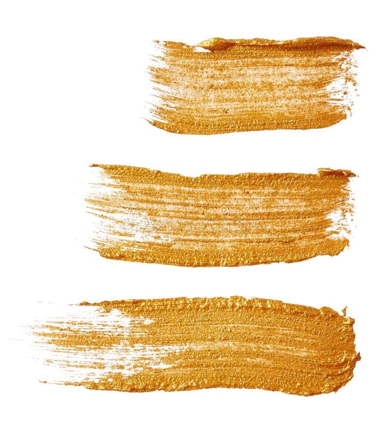 Ходы золотой краски стоковые фото