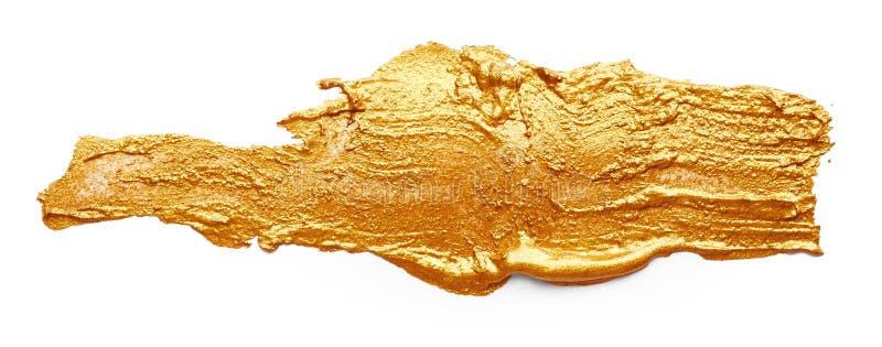 Ходы золотой краски стоковые изображения