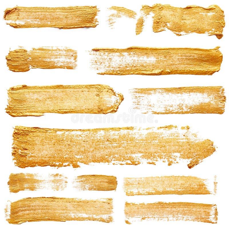 Ходы золотой краски стоковая фотография rf