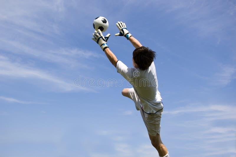 хранитель цели футбола делая за исключением футбола стоковые изображения