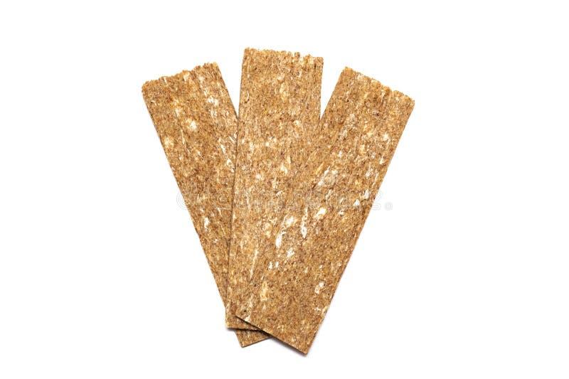 Хрустящие ломти хлеба, изолированные на белой предпосылке стоковое фото