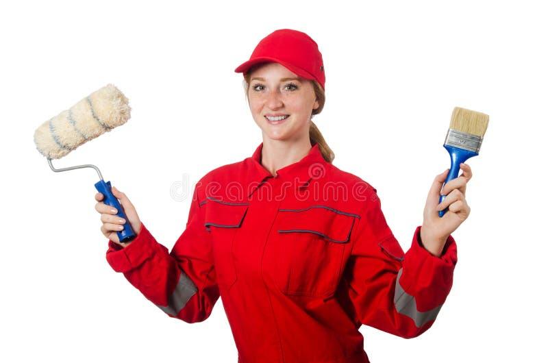 Художник женщины в красных изолированных coveralls стоковые изображения rf