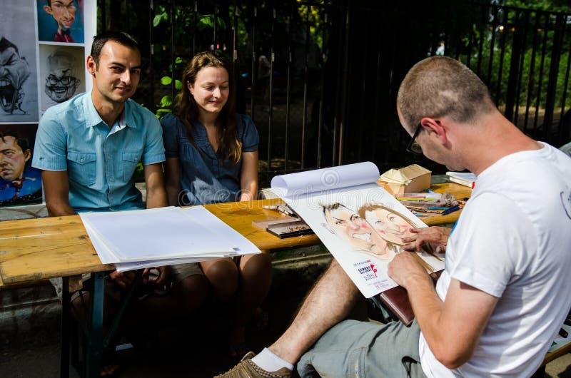 Художник улицы в Бухаресте стоковое фото rf