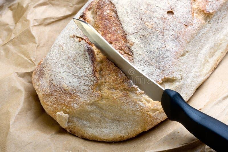 Хлеб и нож стоковая фотография