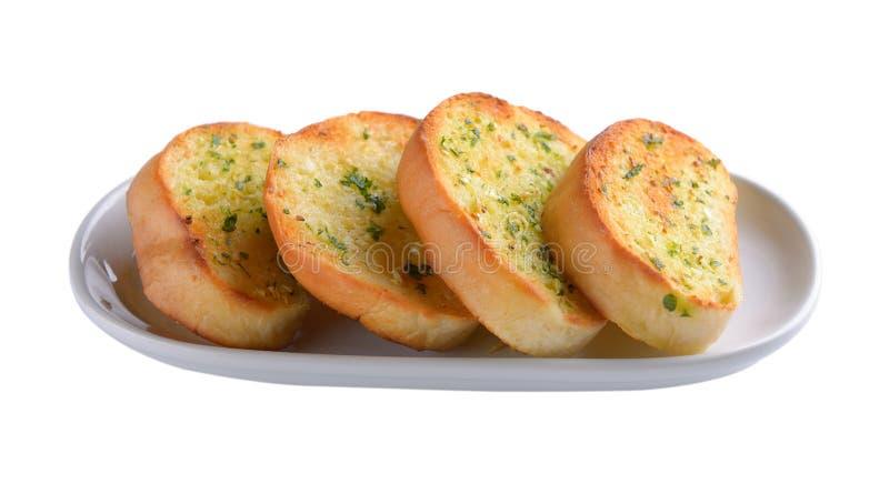 Хлеб чеснока в белой плите стоковое фото