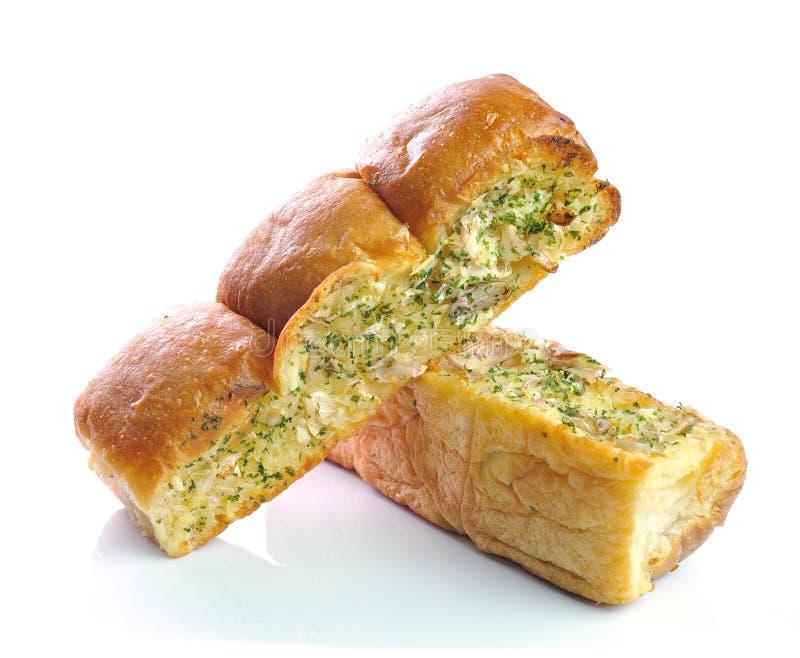 Хлеб чеснока и травы на белой предпосылке стоковое фото rf