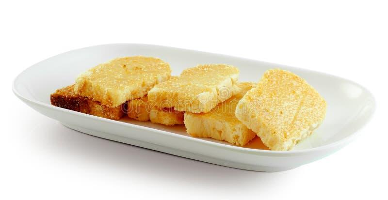 Хлеб чеснока на белой плите стоковые изображения