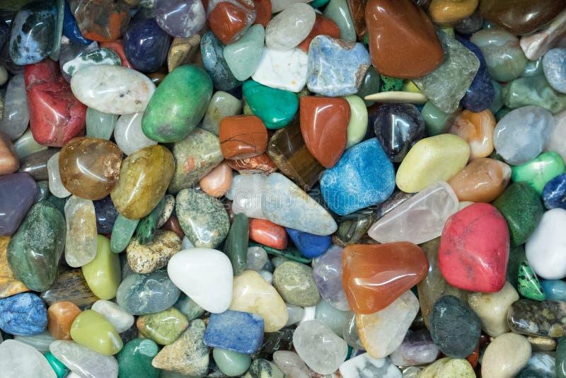 Цветастые отполированные камни стоковое фото