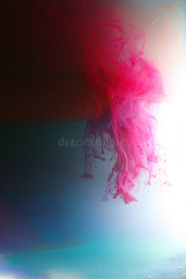 цветастые плавая чернила стоковое фото rf