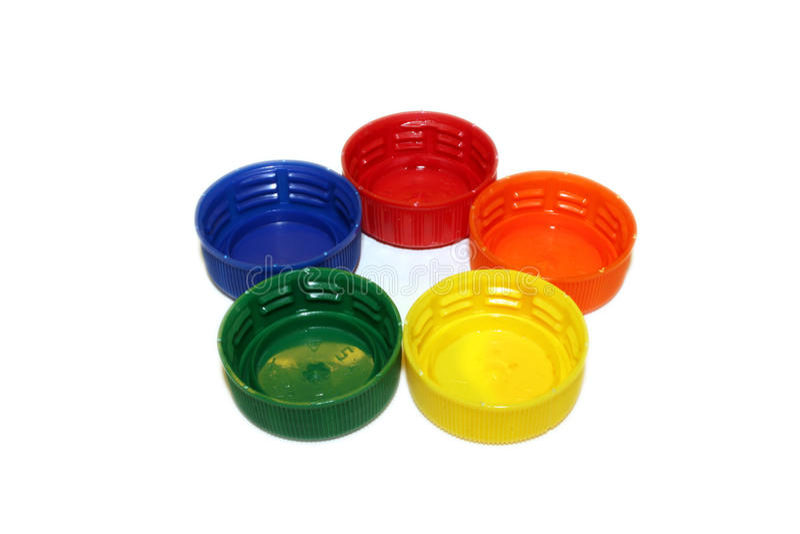 Цветастые пластичные крышки бутылки стоковое фото rf
