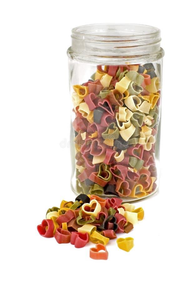 цветастые сердца jar макаронные изделия стоковое фото rf