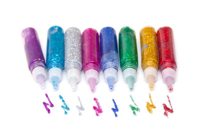 цветастыми sparkle клея установленный перями стоковые изображения