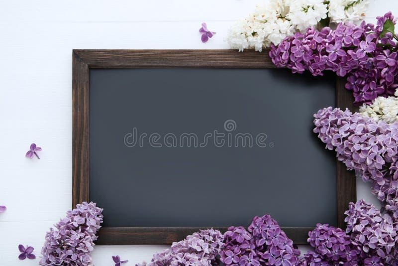 Цветки сирени с черной рамкой стоковое фото rf