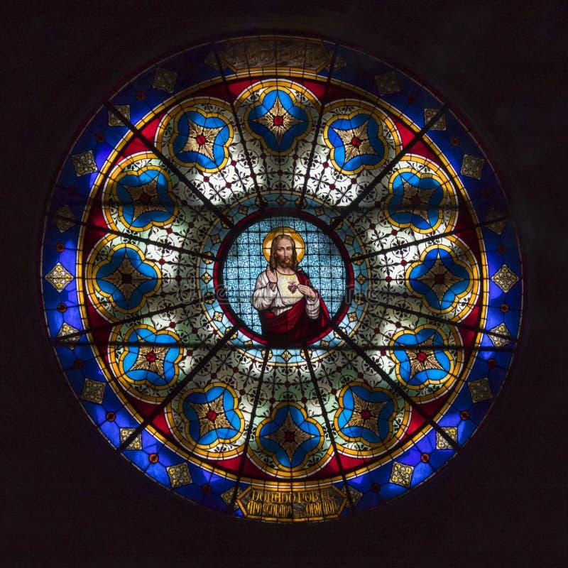 Цветное стекло Иисуса в соборе стоковое фото rf