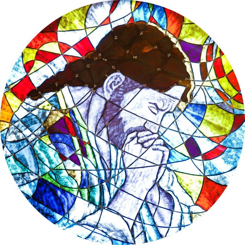 Цветное стекло показывая Иисусу молить стоковые фото