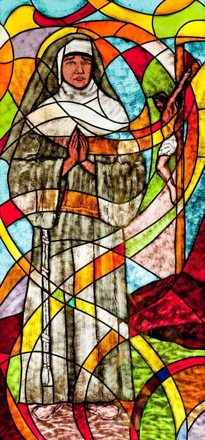 Цветное стекло показывая монашку стоковая фотография